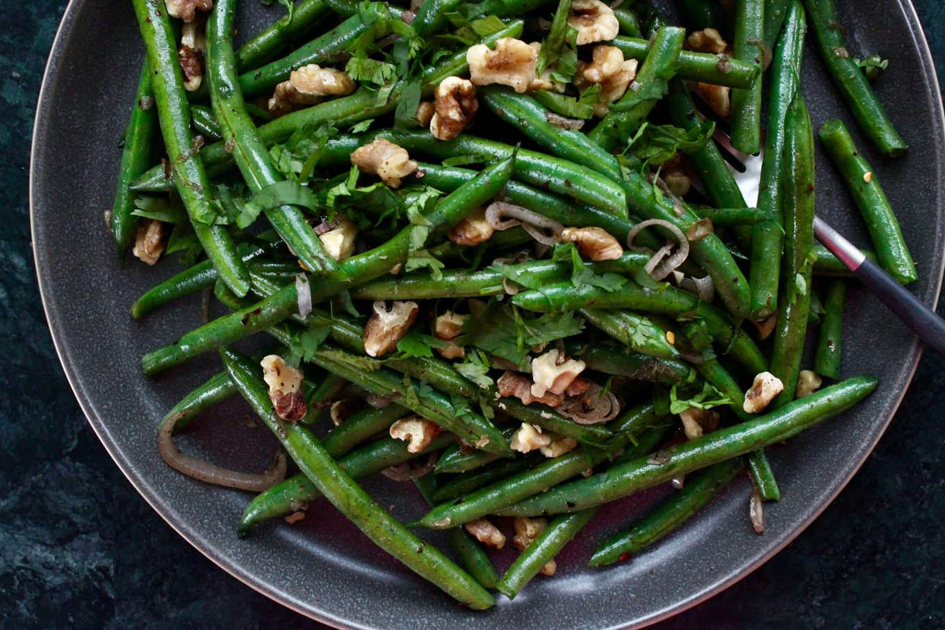 Green Beans with crispy walnuts closeup